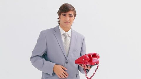 954324810-lifting-the-telefone-receiver-old-fashioned-executive-business-attire